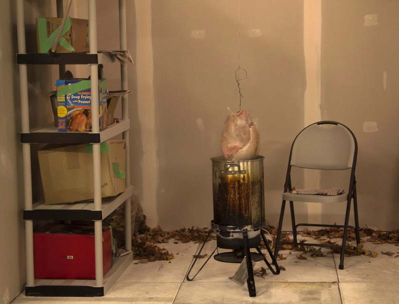 Here's a turkey ready to cook in a turkey fryer with hot oil. The fryer is in a garage. Click next to see what happens.