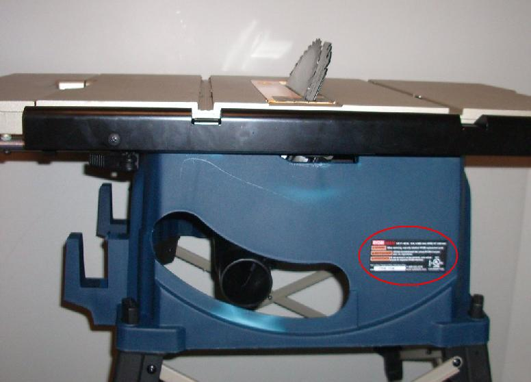 Picture of Recalled table saw showing location of label on rear of saw