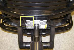Picture of the underside of the recalled chair, showing location of the crack