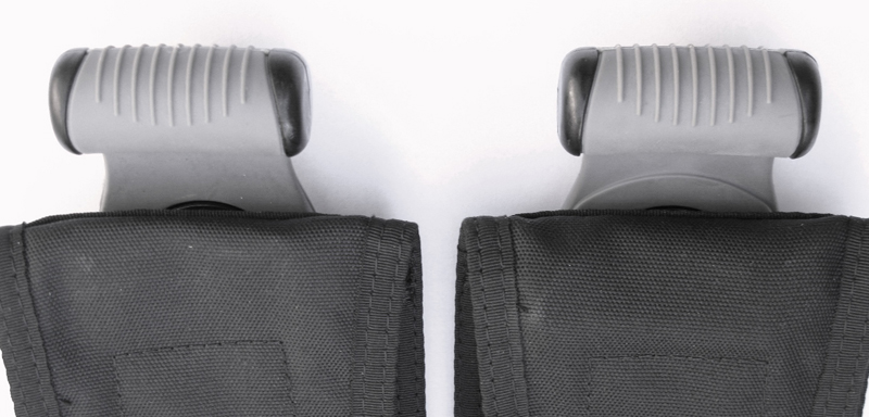 Recalled weight pocket handle (left), upgraded weight pocket handle with band of thicker rubber. (right)