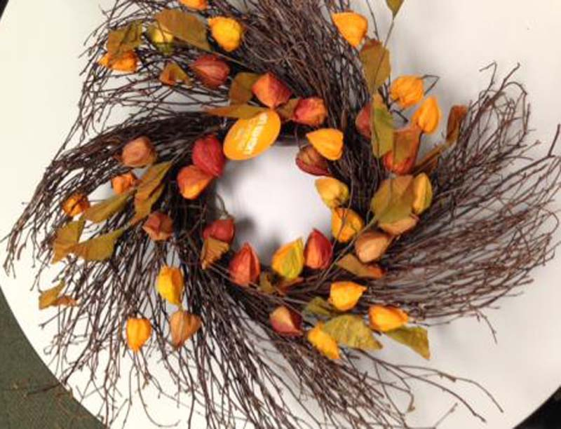 Autumn wreath with silk leaves and Chinese Lantern fruit