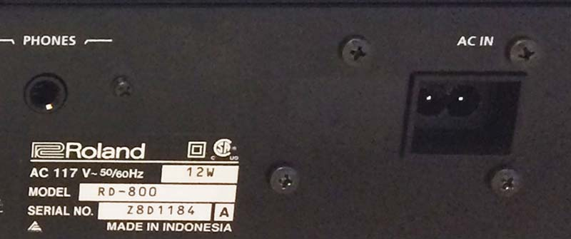 Model number and serial number location on the rear of the piano
