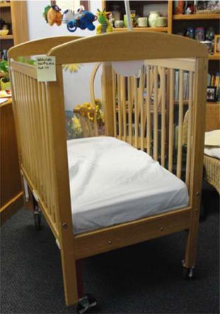 Picture of Generation 2 Worldwide SafetyCraft crib showing the clear plastic sides
