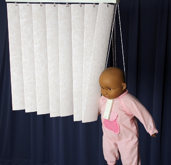 Picture of recalled vertical window blind showing cord strangulation hazard