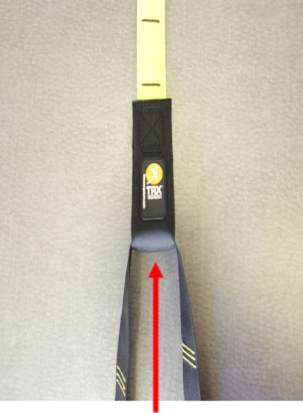 Picture of recalled suspension trainer device indicating absence of a nylon locking loop