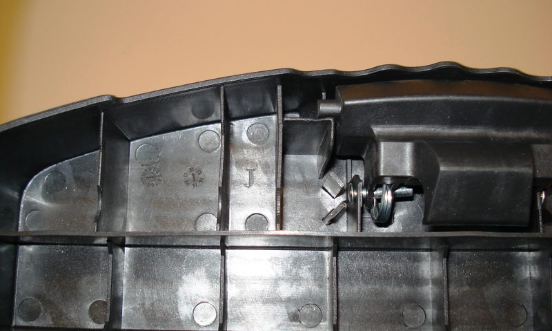 """J"" is stamped on the underside of the top step, left of the locking mechanism"