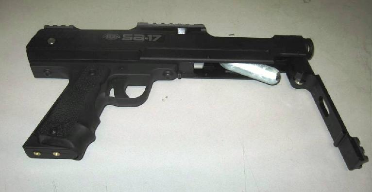 Picture of Recalled BT SA-17 paintball maker with lever to CO2 cartridge chamber open