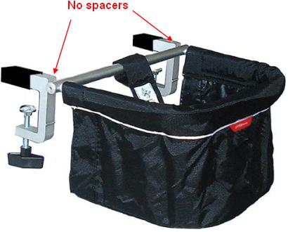 Picture of recalled clip-on chair pointing the lack of spacers between the cross bar and clamps