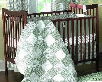 Picture of recalled 343-9105 drop-side crib and changer