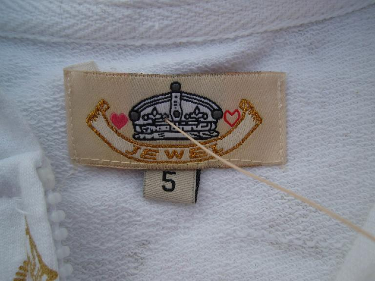 Picture of Neck Tag on Recalled Hooded Sweatshirt