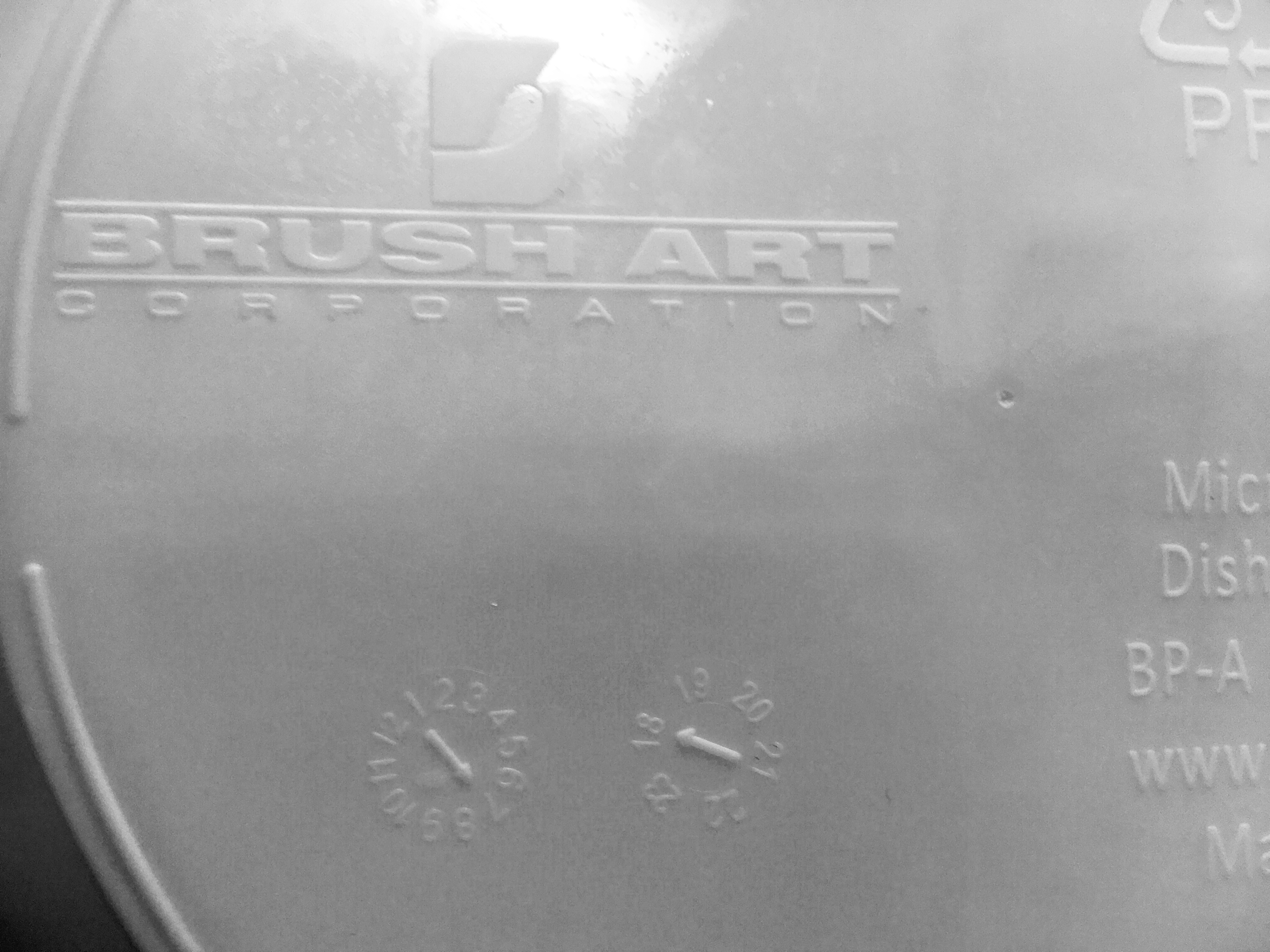 Back of WIC Nutrition Plate – Brush Art logo and date code