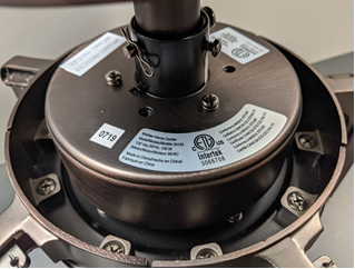 Top of fan motor on recalled Kichler ceiling fans (location of model number)