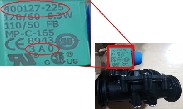 Recalled valve kit with product number displayed at the top of the green coil component and date code printed at the bottom