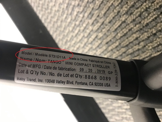 Recalled stroller model number is printed in black on a white sticker attached to the stroller's leg