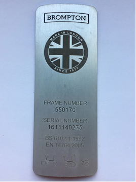 Metal plate featuring 6 digit frame number