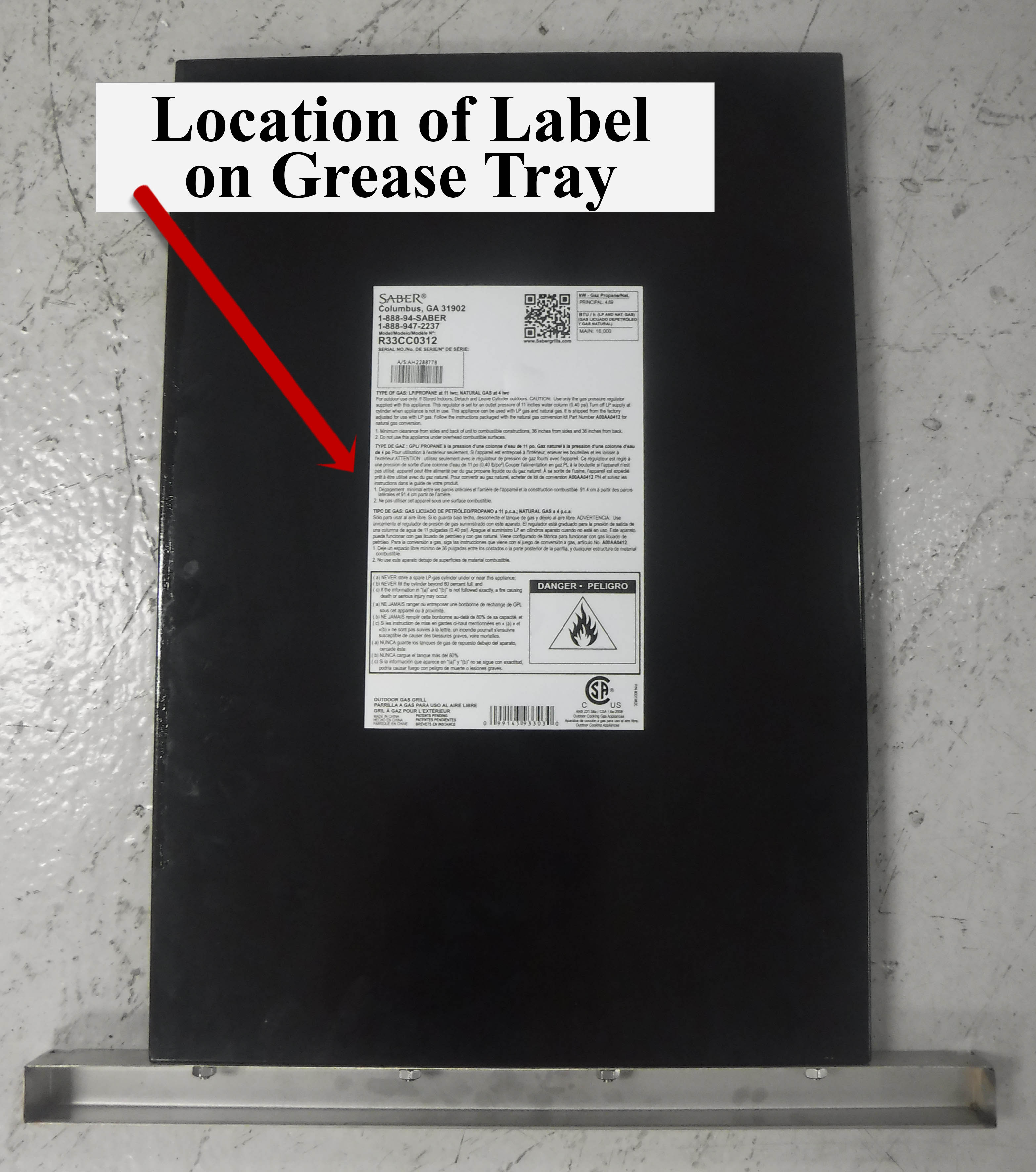 Label on underside of grease tray