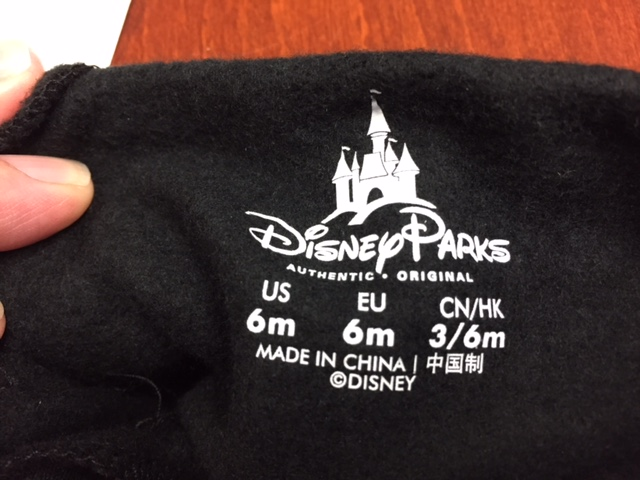 Disney Parks and the size are printed on the inside back of the hoodie's neck