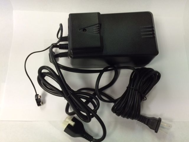 Power supply with cover attached