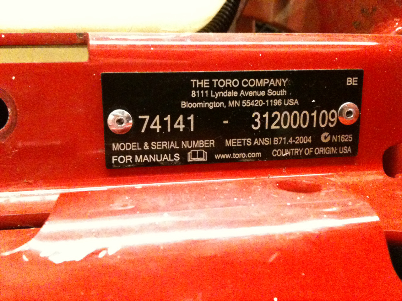 Model and serial numbers located at the front of the mower, below the seat, on the left-hand side