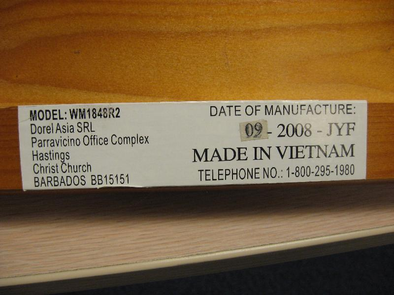 """Example of a label found on one of the side rails. Not all labels will identify """"Dorel Asia SRL"""" in the text"""
