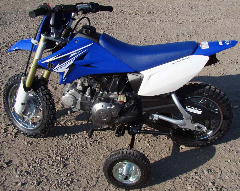Recalled training wheels mounted on a Yamaha TT-R50