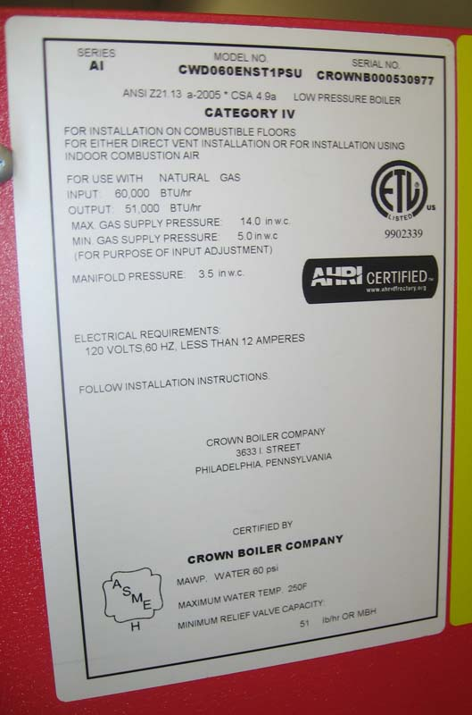 The model number and the manufacturing date are located on a white rating label located on the upper right side of the boiler.