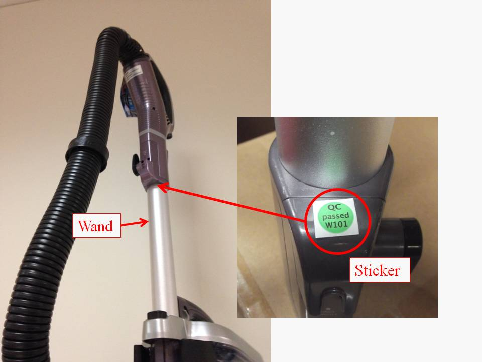 Location of sticker on vacuum cleaner