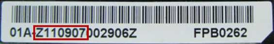The serial number is located on the white battery label