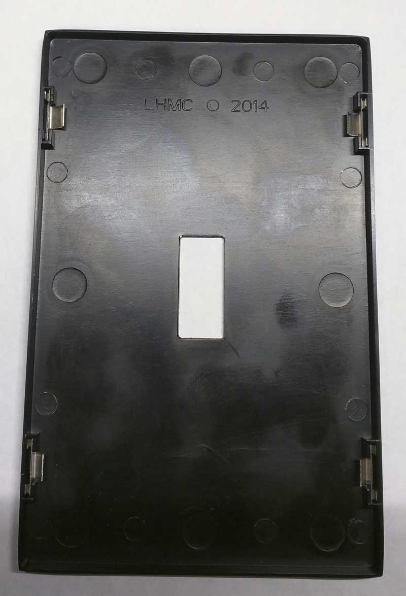 "Back of decorative wall plate with ""LHMC"" stamped"