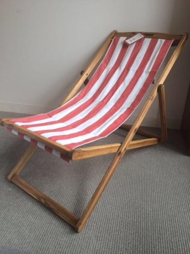 T.J. Maxx and Marshalls foldable lounge chair with red and white stripe fabric