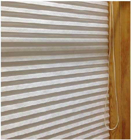 Recalled Carra Imports cellular shade with a continuous loop cord