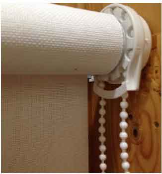 Recalled Carra Imports roller shade with a continuous loop bead chain