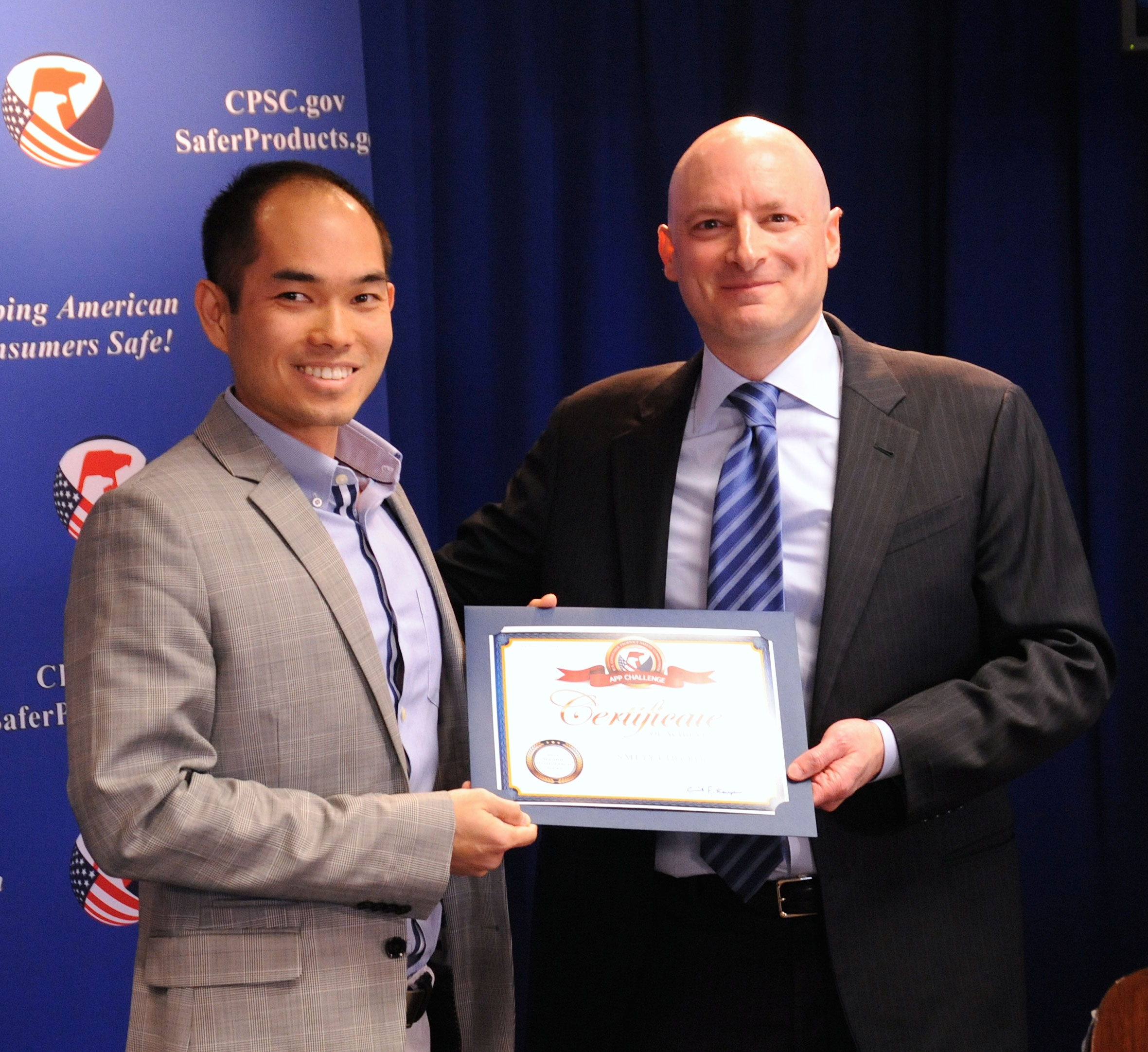 "Tom Nguyen receives his certificate from Chairman Kaye. Tom won ""Most Innovative"" category for his Safety Checker app."