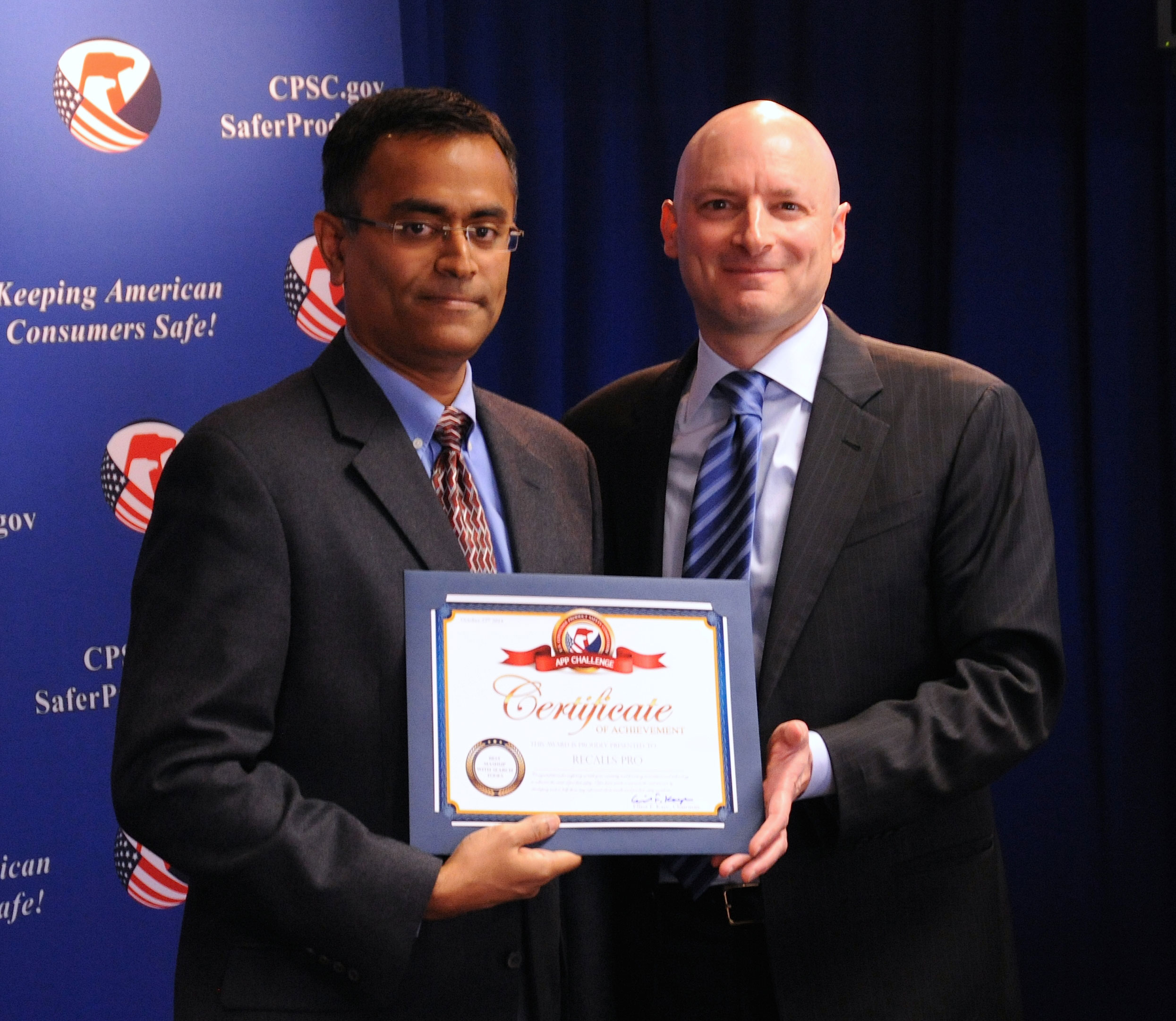 "Zech Kottilil receives his certificate from Chairman Kaye. Zech won ""Best Mashup with Search Tools"" category for his Recall Pro app."