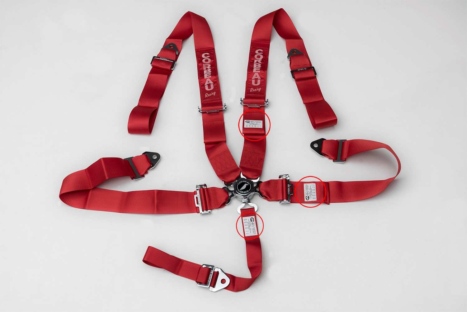 Red 5-Point Camlock Harness Belt with locations of label containing manufacture date highlighted.