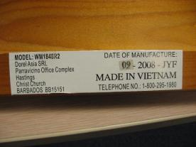 "Example of a label found on one of the side rails. Not all labels will identify ""Dorel Asia SRL"" in the text"