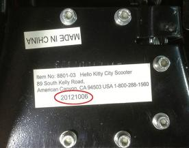 The model number and the manufacture date are printed on a label on the underside of the scooter