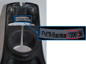 The serial number and date code are inside the base bar on the rear wall.
