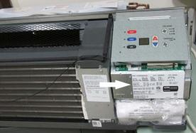 Model and serial numbers can be found by lifting the unit's front cover.