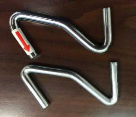 Replacement heavier-gauged S-shaped hook (top) and original Z-shaped hooks (bottom)