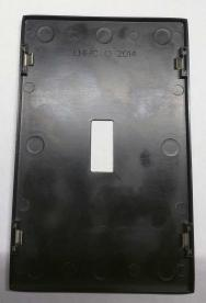 """Back of decorative wall plate with """"LHMC"""" stamped"""