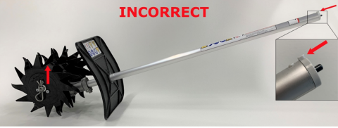 Recalled mini-cultivator (the gearbox is mounted incorrectly and upside down).  The axle is above the drive tube when the locating lug for coupling to the powerhead is facing up.