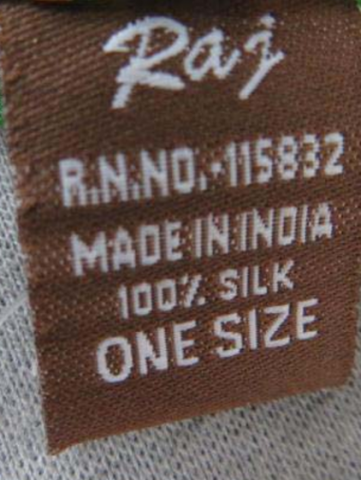 Label located on the scarf's side seam