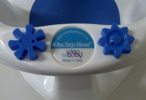 "The web address ""www.onestepahead.com"" appears on the One Step Ahead model of the Idea Baby bath seat."