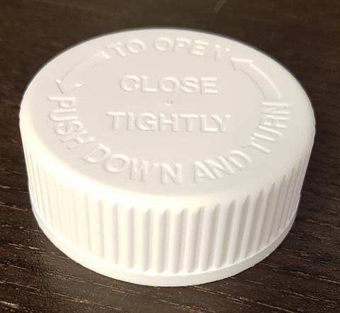 Bottle cap with indented lettering
