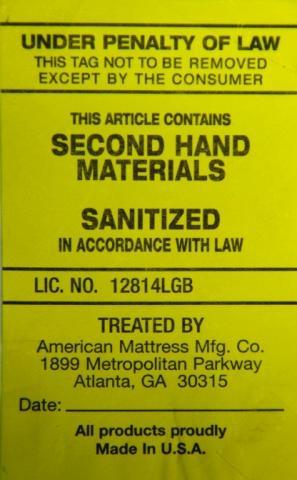 Yellow label on recalled American Mattress Manufacturing mattresses