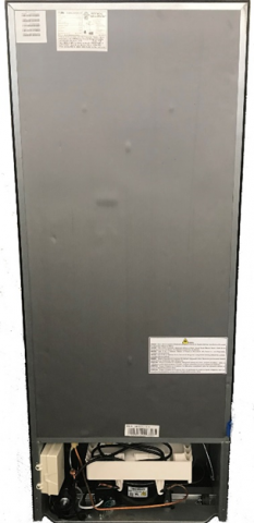 Rear of the recalled Haier 10.1 Cubic Foot Top-Mount Refrigerator with the serial number on a label at the top left.