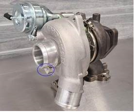"""Part Number """"3023738"""" appears on a rectangular area on the passenger side of the turbocharger."""
