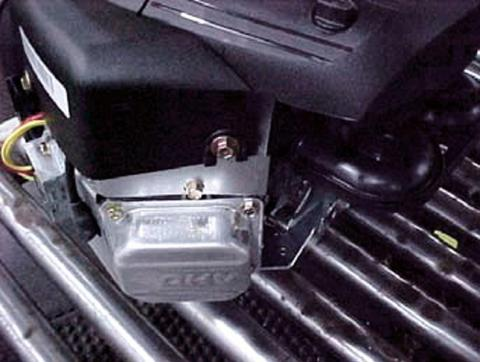 The valve cover is located at the front of the engine near the oil dipstick
