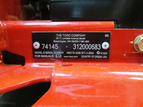 Model and serial numbers located at the front of the mower, below the seat, on the right-hand side.
